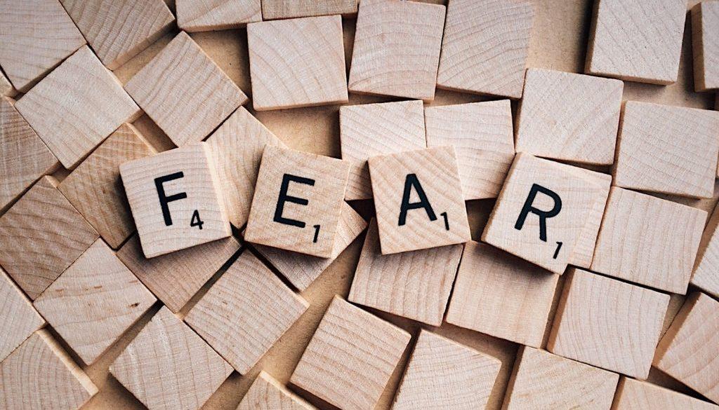 Scrabble blocks spelling the word fear
